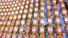 Chinese paper lamp wall in the wind close up view in a sunny day Stock Footage