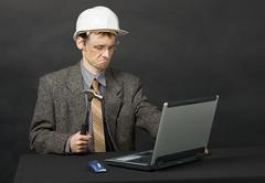 Man intends independently to repair computer Stock Photos