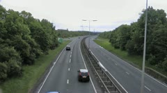 Dual carriageway from footbridge over the road - stock footage
