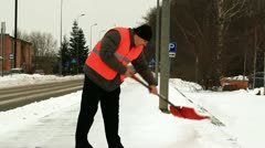 Man with a snow shovel clean the sidewalk Stock Footage