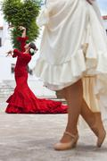 Two traditional women spanish flamenco dancers in town square Stock Photos