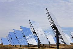 field of renewable green energy solar mirror panels - stock photo