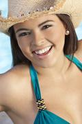 beautiful happy latina hispanic woman in bikini and cowboy hat - stock photo