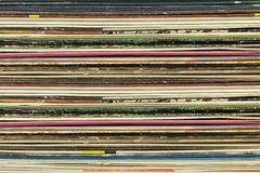 Old record carton covers stacked in pile Stock Photos