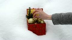 Hand take christmas toy retro colorful box winter snow Stock Footage