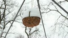 closeup wicker basket hang cover snow move wind - stock footage