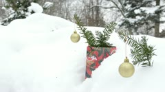 Glossy christmas tree toys coniferous branch winter snow Stock Footage