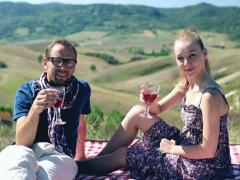 Picnic - Romantic happy couple celebrating with wine in sunny nature, crane shot Stock Footage