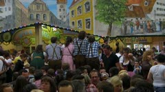 Oktoberfest Germany Munich Beer Festival Beer tent visitor enjoying Stock Footage