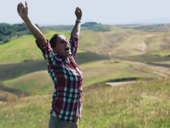 Young woman enjoying panoramic view of Tuscany, slow motion - stock footage