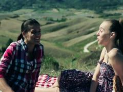 Two girlfriends relaxing on picnic, crane shot Stock Footage