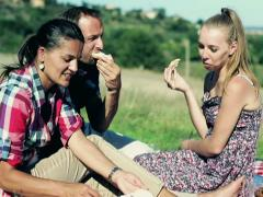 Group of happy friends eating sandwiches on picnic Stock Footage