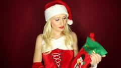 Santa girl throws Christmas stockings Stock Footage