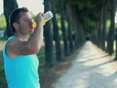 Young people jogging in summer park, crane shot Stock Footage