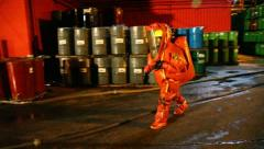 Firefighters practice sealing of leak from corrosive toxic hazardous material Stock Footage