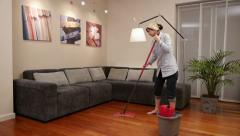 Cleaning lady living room mop Stock Footage