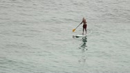 Paddle boarder boarding Stock Footage