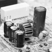 electronic component on old mainboard - stock photo