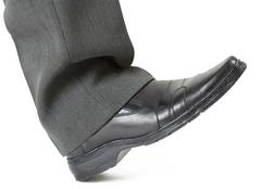 Foot in a shoe ready to crush Stock Photos
