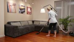 Cleaning lady living room vacuum cleaner Stock Footage