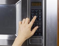 Using microwave oven Stock Photos