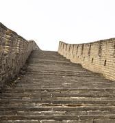 large and steep staircase at the great wall - stock photo