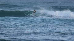 Surfer riding catching a wave Stock Footage