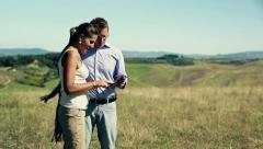 Husband with tablet computer showing property to wife, crane shot Stock Footage