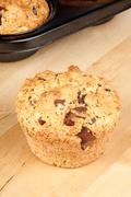 Chocolate chip and pine nut muffin Stock Photos