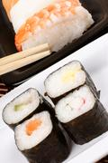 assorted sushi with chopsticks - stock photo