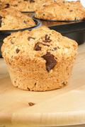 Pine nuts and chocolate muffin Stock Photos