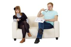father reading newspaper, daughter watching tv - stock photo