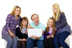 Large family with a laptop Stock Photos
