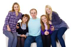 Big family on couch - four women and one man Stock Photos