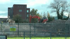 Demolishing Tower Block Digger On Rubble Stock Footage