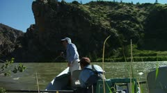 Guide and Angler Pull Anchor and float down towards Canyon Stock Footage