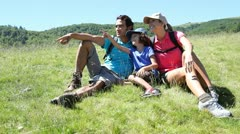 parents and kid on a hiking day in mountain - stock footage