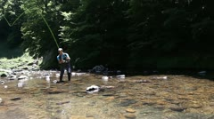 man flyfishing in river - stock footage