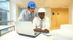 architects working on construction project - stock footage