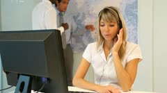 Woman talking on the phone with headset on Stock Footage