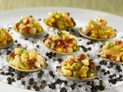 Chilled Littleneck Clams with Linguica, Potatoes and Chives Stock Photos