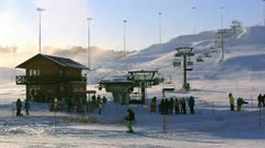 Chair lift at a ski resort on a clear and cold weather Stock Footage