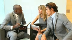 Business team meeting in lounge room Stock Footage