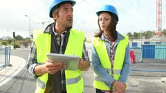 construction people walking on construction site - stock footage