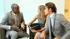 Business people meeting in lounge room Stock Footage