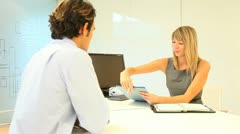 real-estate agent with man signing contract in office - stock footage
