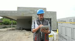 construction manager on building site using tablet - stock footage