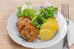 hamburgers with mint and potatoes - stock photo