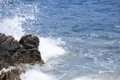 wave splashing on a rock - stock photo