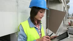 woman engineer using tablet and walkie-talkie - stock footage